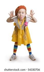 little girl grimacing.