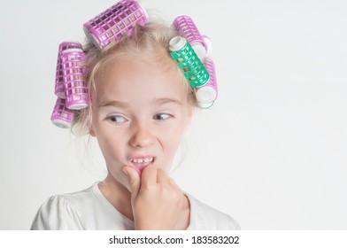 Little girl in hair-curler