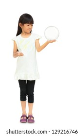 Little girl Hand holding a Glass Ball, Isolated over white