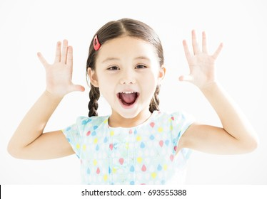 happy little girl with hands up