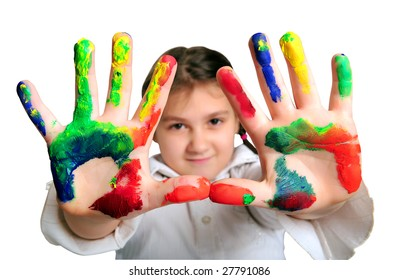 Little girl with hands dirty with paint