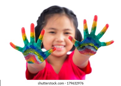 Little girl with hands painted in colorful paint on white background
