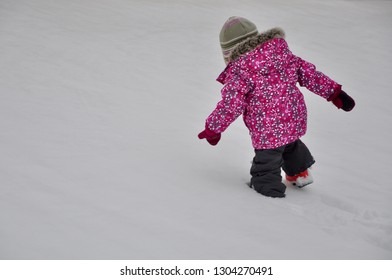 Little girl hardly walking in snowy grounds