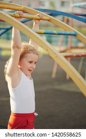 little girl has fun on monkey bar