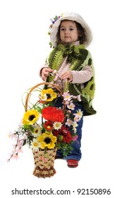 Little girl in a hat with a basket of artificial flowers