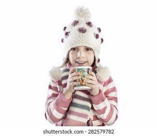 Little girl in hat and with a mug in her hands