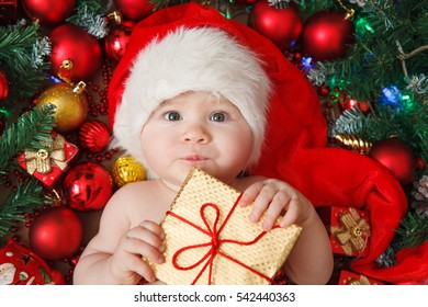little girl in the hat of Santa Claus with gift