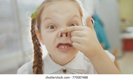 Little girl have funny, smiling and shows piggy nose