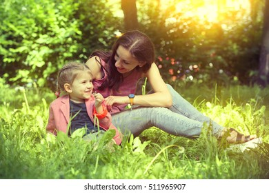Little Girl Having Fun with her Mother in Park, Outdoor, Summer, Canada
