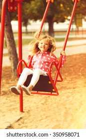 Little girl having fun on swing, outdoor