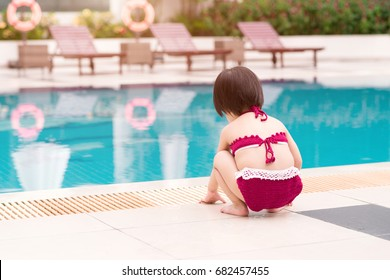 Little girl having fun in the pool. Summer holidays and vacation concept