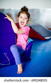 Little girl having fun at soft play