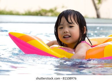 Little girl is having fun in swimming pool