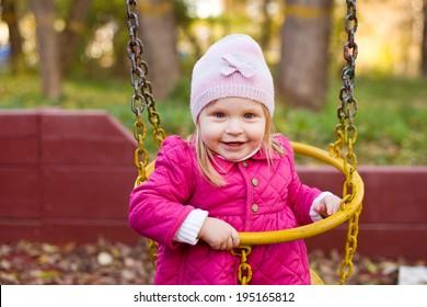 Little Girl Having Fun Swinging