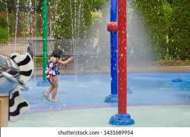 Little girl having a good time at splash pad