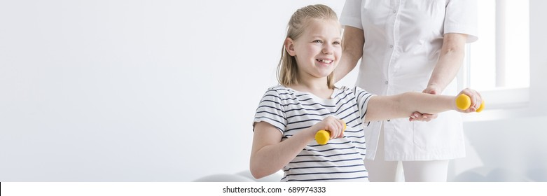 Little girl having physiotherapy to prevent spine defects in future