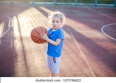 Little girl having a rest during basketball play