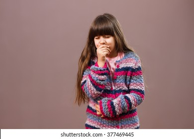 Little girl is having stomachache and she is going to vomit.I am sick!