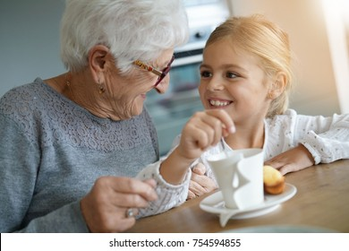 Little girl having tea time with grandma
