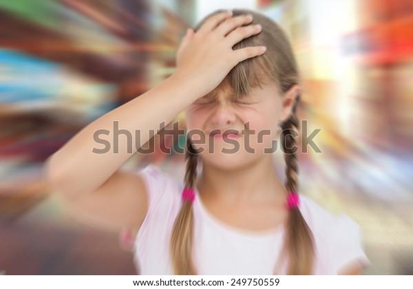 Little girl with headache against blurred new york street