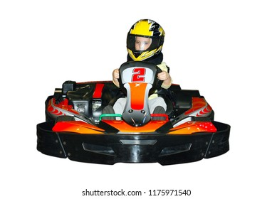 a little girl in a helmet in the go-kart is isolated on the white background