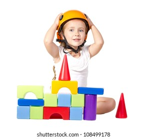 little girl  in helmet playing with blocks, looking at camera  isolated on white
