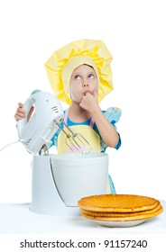 A little girl helps prepare cake