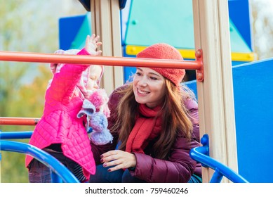 little girl and her beautiful young mother playing in the autumn park, playground. among yellow and red leaves. The concept of family photo, love, mutual understanding, love of children