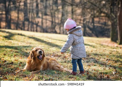 Little girl and her dog portrait on park