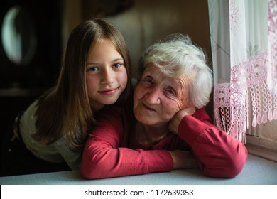 A little girl and her grandmother, portrait.