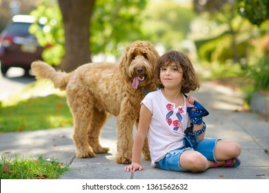 Little Girl with her Labradoodle Dog Outdoors