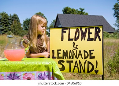 little girl with her lemonade stand