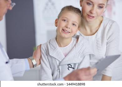 Little girl with her mother at a doctor on consultation