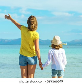 Little girl and her mother on the beach.