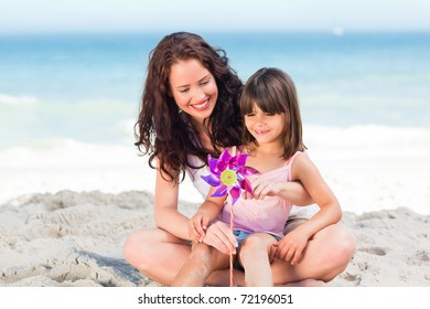 Little girl and her mother with a windmill