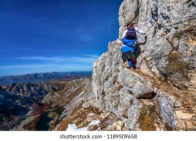 Little girl hiking on the Mountains in National Park Durmitor, Montenegro