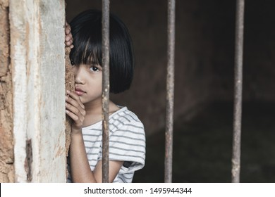 little girl hold cage with eye sad and hopeless, Human trafficking concept, human rights violations, Stop violence and abused children. traumatized children concept.