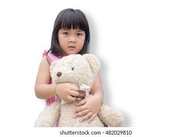 Little girl hold teddy bear on white backgground