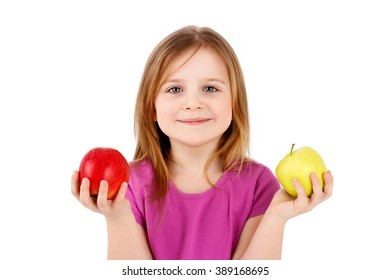 Little girl holding apples