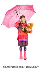 Little girl holding big pink umbrella and her teddy bear