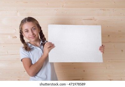 Little girl holding blank white board