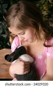 Little Girl Holding Bunny