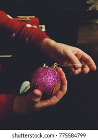 Little girl holding a Christmas bauble