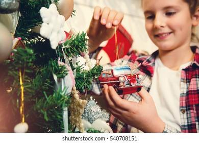 Little girl holding Christmas ornaments