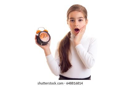 Little girl holding a clock