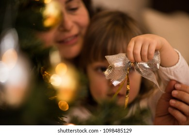 Little girl holding decorative christmas bow