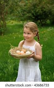 Little girl holding eggs