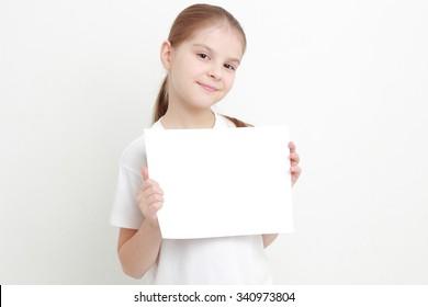 little girl holding empty white blank