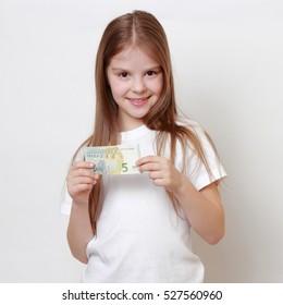 little girl holding euro