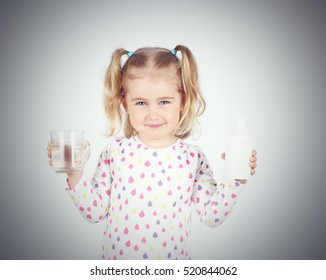Little girl holding a filter for drinking water and a glass of clean water.